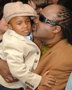 Stevie Wonder kisses his son Kailand's cheek.