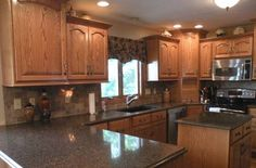 honey oak kitchen cabinets with black countertops | Top of the Line Cambria Quartz & Custom made Cabinets