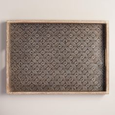 Featuring embossing and a whitewashed finish, our handcrafted metal and wood tray is full of contemporary rustic style. Serve plated snacks or showcase magazines or knickknacks on this decorative accent piece.