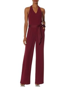 Halter Jumpsuit - Step out in confidence in this drapey wide leg style! A silky sash wraps things up with a pretty finish.