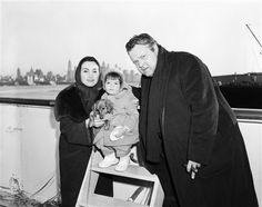 Actor Orson Welles with his wife, daughter Beatrice, and  long hair dachshund, Columbina, 1957.