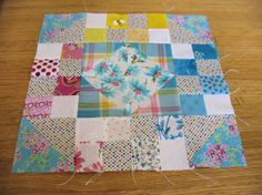 "A traditional block pattern called ""Jewel Box"" pieced by me in May 2014, incorporating gingham and other fabrics from the stash of my aunt Johanna Wackerle Tanner."
