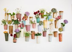Flower wall of neutral pots that can be taken on and off hooks to refill with water