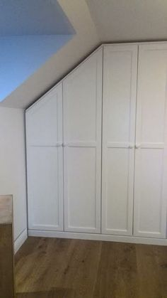 Fitted painted pine wardrobe.