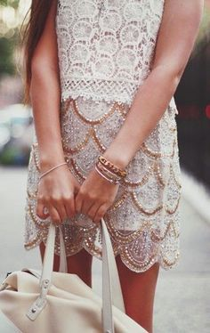 A feminine lace top and beaded skirt combine for the perfect girly look.