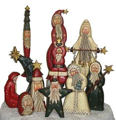 Whispering Pines carved folk art Santas!