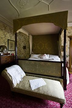 bedroom, Lanhydrock, Cornwall, with gold and pinky-purple