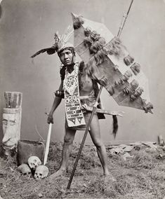 Studio portrait of a 'Dayak dressed as a warrior' Army List, East Indies, Borneo, Gumbo, Studio Portraits, Tribal Art, Historical Photos, Art Google, Old Photos