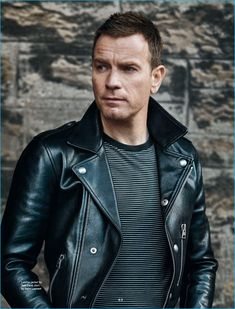 Ewan McGregor is a cool vision in a Tom Ford leather biker jacket with a striped…