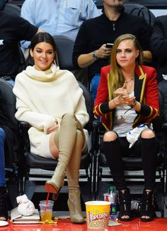 At a L.A. Clippers game with Cara Delevingne. See all of Kendall Jenner's best looks.