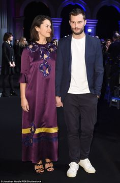 Look of love: The couple - both 34 - held hands as they walked the red carpet together
