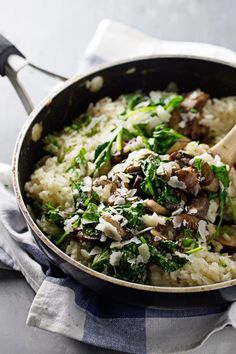 Garlic Butter Mushroom Risotto - A quick and easy weeknight meal! White wine, garlic, mushrooms, butter, spinach, and creamy risotto.