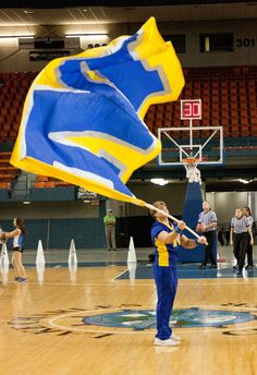 One of the Cheerleaders waves the big M flag during the timeout.
