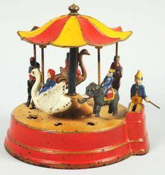 Kyser & Rex 'Merry-Go-Round' cast-iron mechanical bank Vintage Circus, Vintage Toys, Antique Toys, Vintage Antiques, Circus Crafts, Sep 15, Cast Iron, It Cast, Merry Go Round