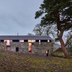 Scottish holiday home by WT Architecture  masquerades as an old stone mill Modern Conversion on old Stone Wall