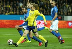 Sweden's midfielder Emil Forsberg (C) and Italy's defender Andrea Barzagli (L) vie for the ball during the FIFA World Cup 2018 qualification football match between Sweden and Italy in Solna,Sweden on November 10, 2017. / AFP PHOTO / Soren Andersson - 79 of 126