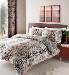 Brown Bed of Contemporary Bedroom with Wooden Side Table beside It