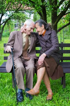 Cute 80 plus year old married couple posing for a portrait in th - Cute 80 plus year old married couple posing for a portrait in their garden. Love forever concept.