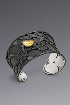 Patricia Tschetter cuff   Argentium(R) Silver, 18kt and 22kt gold. Fused, formed, pierced, granulated, oxidized