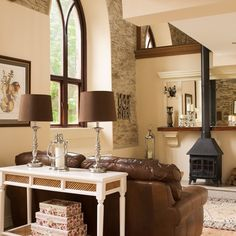 house beautiful purple and brown living room | country living room with stove | living room ideas | 25 Beautiful ...