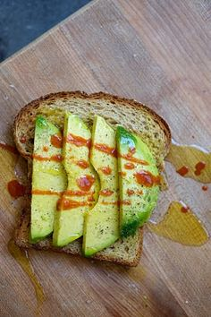 AVOCADO TOAST - whole wheat toast, sliced avocado, salt & pepper, drizzle of olive oil and hot sauce. Delicious and simple!