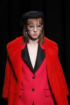 Gucci Fall 2016 Ready-to-Wear Fashion Show Details. Love this look, she gives fashion fabulous from the 1980's red mixed with a new style of cut in the jacket, mixed with 90's style black buttons. Add the wow of the cover over her face, unique but so beautiful in a subtle way.
