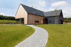 Design and construction of a house near Chrudim, east Bohemia. RD is located on the very edge of the PLA, which directly define the classical form of. Country Modern Home, Modern Barn House, Modern Houses, House Cladding, Exterior Cladding, English Farmhouse, Rural Retreats, Architecture Visualization, Modern Architecture House