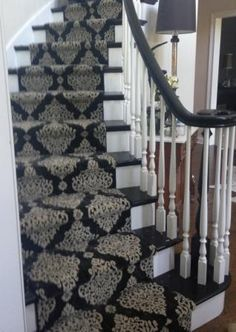this stanton carpet stair runner on a circular stairway in the front hall of this long