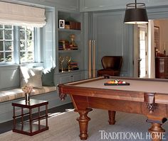 Blue-gray paint in a high-gloss finish covers the millwork and radiates a friendly disposition. - Photo: Michael Garland / Design: Chris Barrett