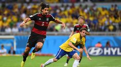Bernard of Brazil is challenged by Sami Khedira of Germany