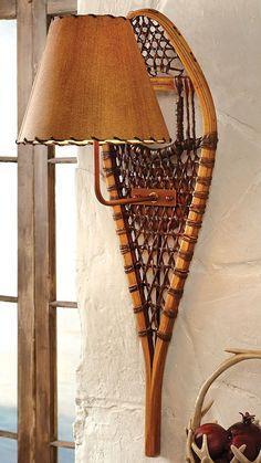 @dmacgill this would be really cool up at camp!   Snowshoe Wall Lamp - Rustic Home Decor