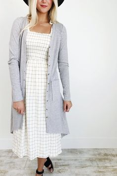 """Heather Gray Rib-Knit Cardigan  Tortoiseshell Button-Up Front  Long Sleeve + Pockets on Front  Hi-Lo Hem  Model is 5'9"""" + Wearing a Small"""