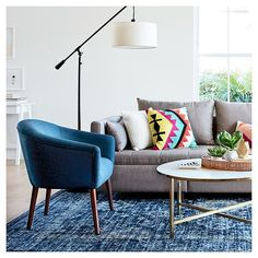 Bring in fresh air with the Modern Colorful Living Room Collection from Threshold. The furniture and home accessories have bright splashes of color, organic textures, and geometric patterns combined to create an eclectic, trend-setting look.