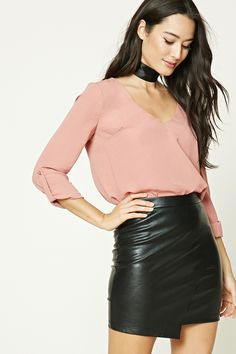 A crinkled satin top featuring a boxy silhouette, V-neckline, and long buttoned roll-tab sleeves.  ALSO comes in a light brown and light blue!!
