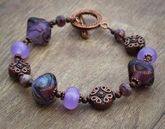 Wife Copper Bracelet. Theres so much to love about this bracelet - the gorgeous diamond-shaped artisan lampwork glass beads with swirls of purples and gold, the enchanting lilac colored lampwork glass spacers, along side Czech glass and copper plated beads and findings. Length: