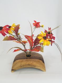 Ikebana: More than just flowers and blossoms, Ikebana often emphasizes other areas of the plant, such as its stems and leaves, and puts emphasis on shape, line, and form. Ikebana is an art form in which nature and humanity are brought together; as such, this handmade Ikebana vase of naturally colored spalted maple is a perfect way to do just that.flowers fresh.