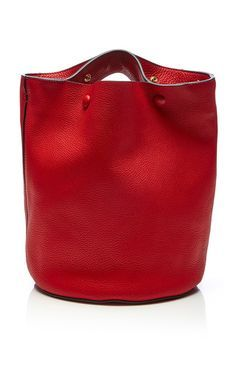 This shoulder bag by **Marni** is rendered in calf leather and features a thick…