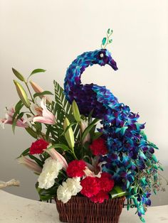A new design of our flower decoration, peacock flowers design, check it out. #flowerdecoration #flowerdesign #flowers #gifts #flowergifts #fnpaue Best Flower Delivery, Flower Delivery Service, Online Flower Shop, Order Flowers Online, Online Florist, Ferns, Floral Wreath, Wreaths, Design