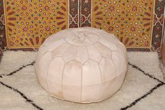Exquisite Moroccan leather pouf hand stitched with the finest quality, locally tanned, leather.  Each piece is handcrafted to the highest standard by