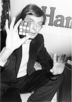 Famous Hungarian People rubik | Hungarian educator Erno Rubik holds up his invention, the Rubik's cube