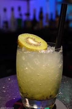 """""""Tribal Crush"""" – kiwi fruit, sugar, Midori, fresh lime juice, Vodka- (I use some Diet 7 up instead of the sugar. Party Drinks, Cocktail Drinks, Fun Drinks, Yummy Drinks, Alcoholic Drinks, Beverages, Cocktails, Malibu Mixed Drinks, Malibu Rum"""