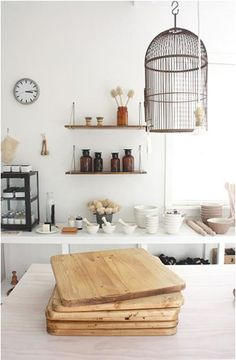 pared back, bright, eclectic with natural materials (not to mention a birdcage!)