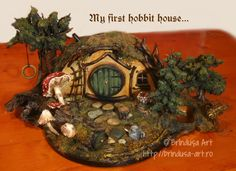Hobbit home I've made from various materials (wood, rocks, tin cans, etc.). The door can be opened. Căsuţă de hobbit pe care am făcut-o din diverse materiale (lemn, pietre, câteva conserve etc.). Uşa se deschide. #woodpainting #picturapelemn #mydesign #hobbit #tolkien #hobbithouse #house #home #littlehouse #miniature #casuta #repurposed #altered #repurposing #recycling #reciclare #tincans #acrylic #acrilics #expanding #cutiepictata #handmade #oneofakind #unique #unicat #creative #BrindusaArt Tin Cans, Love Images, Fun Projects, Painting On Wood, Conservation, Making Out, Repurposed, Decoupage, My Design