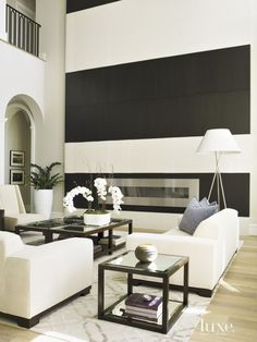 Contemporary White Living Room with Striped Fireplace Wall