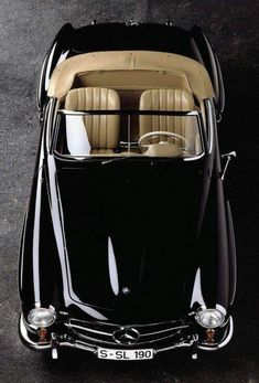 Classic black Mercedes convertible with tan leather interior