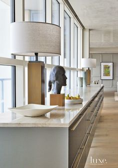 Contemporary Neutral Kitchen with Head Statue | LuxeSource | Luxe Magazine - The Luxury Home Redefined