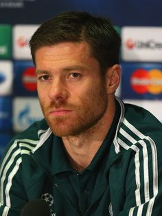 Xabi Alonso Photos Photos - Xabi Alonso of Real Madrid faces the media during a press conference at Old Trafford on March 4, 2013 in Manchester, England. - Real Madrid Training & Press Conference