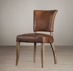ADÈLE LEATHER DINING CHAIR $559 - $609 Our reproduction of a classic 1940s French dining chair cossets in comfort with its gently flared bac...
