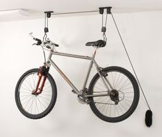 http://www.amazon.com/Racor-PBH-1R-Ceiling-Mounted-Bike-Lift/dp/B00006JBL3/ref=sr_1_1?ie=UTF8=1364332709=8-1=bicycle+pulley+system
