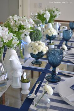 Blue table setting with alstroemeria and chrysanthemum centerpieces. I ADORE the use of egg cups and moss as name tags.